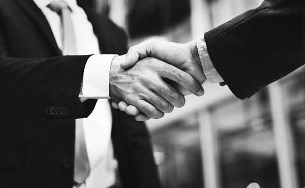 Sales handshake with client