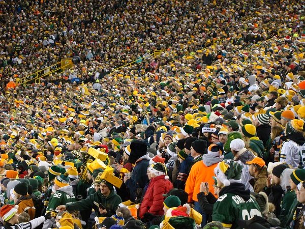 Green Bay Packers Fans cheering and sharing in the story of their team